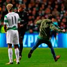 Hatton runs onto the pitch to confront PSG striker Kylian Mbappe