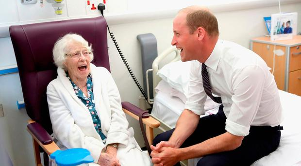 The Duke of Cambridge shares a joke with patient Theresa Jones at the opening of the Urgent Care and Trauma Centre (UCAT) at Aintree University Hospital, Liverpool