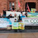 Protesters against the establishment of a gold mine in the Sperrins by Canadian company Dalradian Resources outside Londonderry's Guildhall