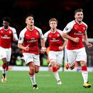Arsenal's Alexis Sanchez (second left) celebrates scoring his side's first goal of the game during the Europa League match at the Emirates Stadium, London. Nick Potts/PA Wire