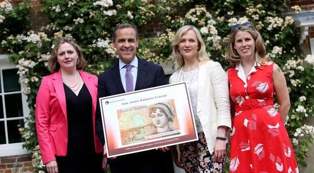 Caroline Criado-Perez (far right) with MP Mary Macleod, Bank of England governor Mark Carney and MP Stella Creasy with the concept of the new £10 note. Photo: Chris Ratcliffe/PA