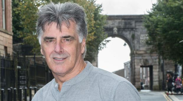 The town he loves so well: Felix Healy at Derry's historic Bishops Gate. Photo: Martin McKeown/Inpresspics