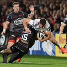 Force: Leigh Halfpenny crunches into Ulster try scorer Jacob Stockdale