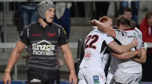 Ulster celebrate John Andrew's try during the win over Scarlets
