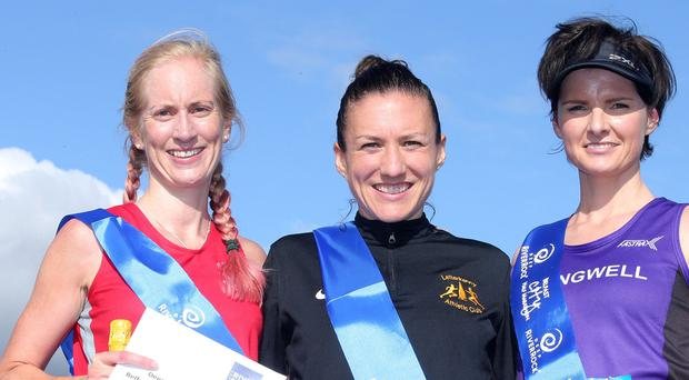 Press Eye Belfast - Northern Ireland 15th September 2017 Deep River Rock Belfast City Half Marathon takes places across the city with over 3,500 runners taking part. Left to right female race. Judith Lonnen in third, Catrina Jennings in first and Ciara Toner in second are presented with the prizes. Picture by Jonathan Porter/PressEye.com