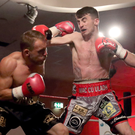 Dramatic twist: Tyrone McCullagh (right) takes on Craig Derbyshire who was disqualified