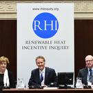 The Chairman, the Right Honourable Sir Patrick Coghlin, pictured with Dame Una O'Brien (left) and Dr Keith MacLean OBE (right) , who makes a statement at a third preliminary hearing of the Public Inquiry into the non-domestic renewable heat incentive (RHI) scheme in the Senate Chamber, Parliament Buildings, Stormont, Belfast, on Monday Pic Colm Lenaghan/Pacemaker