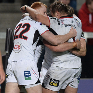 Huddle time: John Andrew is mobbed after his try in Ulster's victory against the Scarlets in Belfast