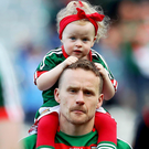 Pain and joy: A dejected Andy Moran with his daughter
