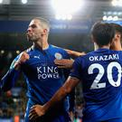 Islam Slimani of Leicester City celebrates scoring his sides second goal with Shinji Okazaki of Leicester City during the Carabao Cup Third Round match between Leicester City and Liverpool at The King Power Stadium on September 19, 2017 in Leicester, England. (Photo by Matthew Lewis/Getty Images)