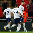 Coolly done: Dele Alli (right) celebrates with Kieran Trippier and Harry Winks