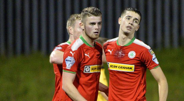 Double trouble: Cliftonville's Rory Donnelly celebrates with his brother Jay