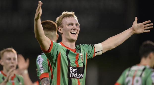 Hot shot: Glentoran's Steven Gordon celebrates his strike against Crumlin last night