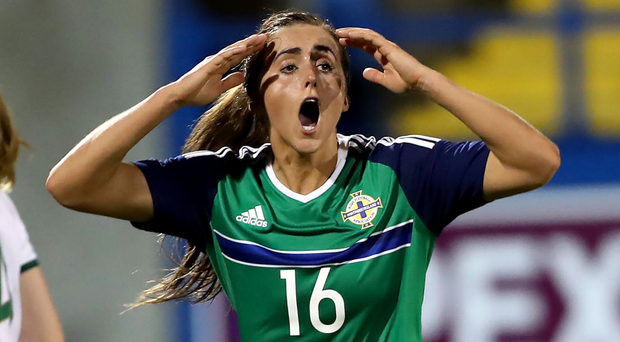 So close: Northern Ireland's Kendra McMullan after her header was saved by Republic of Ireland's Marie Hourihan