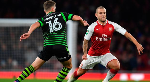 Wil power: Jack Wilshere takes on Doncaster's Jordan Houghton. Photo: Ben Stansall/Getty Images