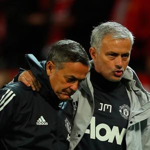 Ricardo Formosinho, Manchester United coach speaks with Jose Mourinho, Manager of Manchester United after the Carabao Cup Third Round match between Manchester United and Burton Albion at Old Trafford on September 20, 2017 in Manchester, England. (Photo by Richard Heathcote/Getty Images)