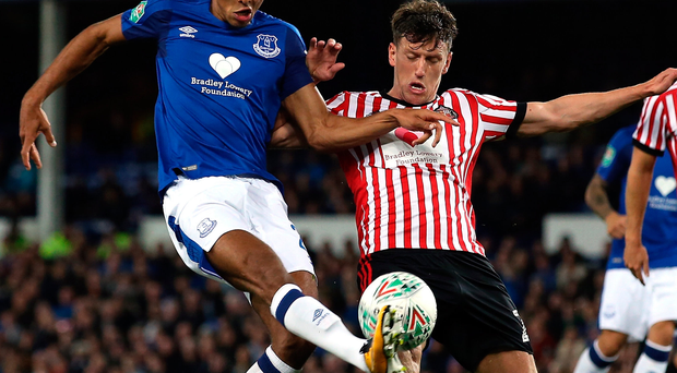 Everton's Dominic Calvert-Lewin shoots while under pressure from Billy Jones of Sunderland. Photo: Jan Kruger/Getty Images