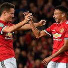 Three and easy: Jesse Lingard (right) celebrates with Ander Herrera after netting the third goal in Manchester United's defeat of Burton Albion. Photo: Getty Images