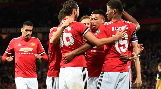 On the way: Manchester United salute Marcus Rashford's opening goal. Photo: Getty Images