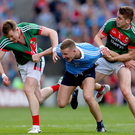 Gripping stuff: Mayo duo Donal Vaughan and Lee Keegan take on Ciaran Kilkenny. Photo: James Crombie/INPHO
