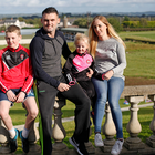 Family time: Eoin Bradley relaxes at his Kilrea home with his partner Emma and children Cathaoir and Cara. Photo: Peter Morrison
