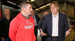 European Parliament Brexit chief Guy Verhofstadt (right) speaks with farmer Arthur Hughes at his farm on the Armagh and Monaghan border. Photo: Getty Images