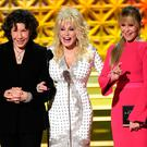 Vintage style: Jane Fonda (right) with Lily Tomlin and Dolly Parton on stage at the 69th Primetime Emmy Awards