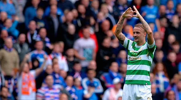 Leigh Griffiths celebrates netting Celtic's second at Ibrox.