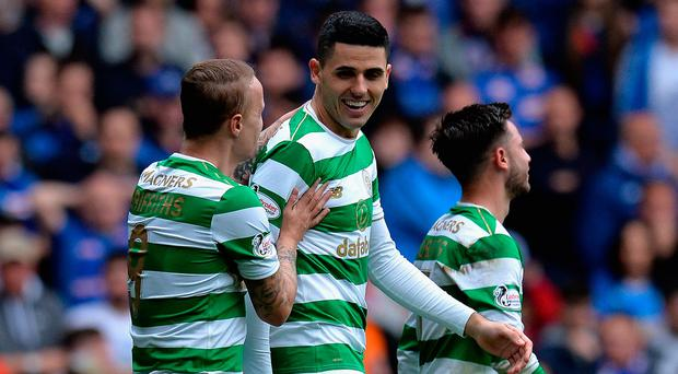 Tomas Rogic celebrates opening the scores for Celtic in the season's first Old Firm derby.