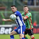 Glentoran's Nathan Kerr and Coleraine's Eoin Bradley during the game at the Oval in Belfast.