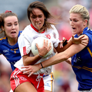 Gripping stuff: Tyrone's Niamh Hughes wrestles with Tipperary's Jennifer Grant
