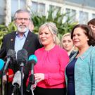 Gerry Adams with Sinn Fein colleagues Michelle O'Neill and Mary Lou McDonald