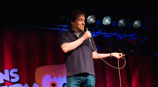 Ardal O'Hanlon on stage at Queen's Comedy Club