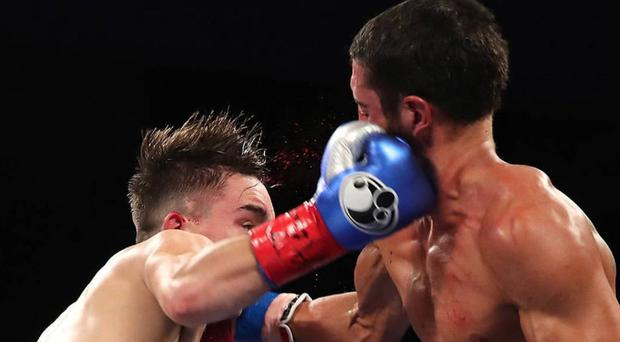 Right on target: Michael Conlan lands a punch on Kenny Guzman