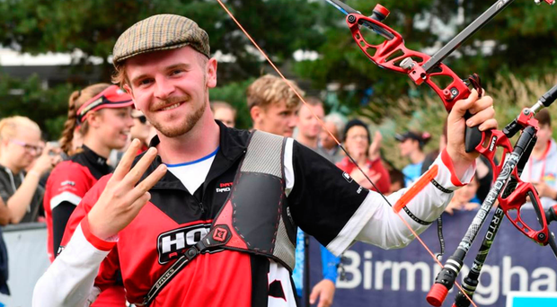 Cap that: Patrick Huston marks his historic third successive GB title win