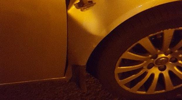 A police vehicle in Newry has been damaged by bricks and fireworks