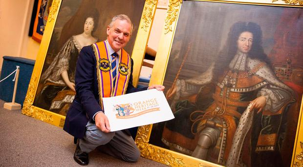 County Fermanagh Grand Master Stuart Brooker with the historic Williamite portraits