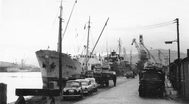 Ships from Scandinavia unloading timber in the Port of Newry c.1969. The site of the docks is now occupied by The Quays Shopping Centre. (Newry and Mourne Museum)