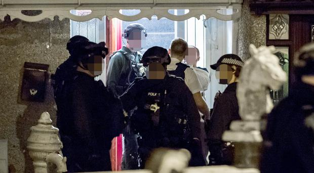 Heavily armed police units make an arrest at a house in the Moyard area of west Belfast at 2am during an incident on September 27th 2017 (Photo by Kevin Scott / Belfast Telegraph)