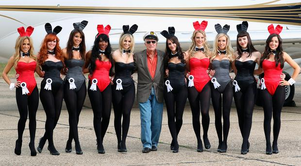 Playboy magazine founder Hugh Hefner passed away on September 27 at the Playboy Mansion. He was 91 years old. In 2002 Hefner (centre) arrives at Stansted Airport on. The photograph is a recreation of a picture originally taken in the 1960s, with 10 of the new London Bunnies. (Photo by Dan Kitwood/Getty Images)