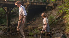 Child's play: Domhnall Gleeson as Milne and Will Tilston as his young son