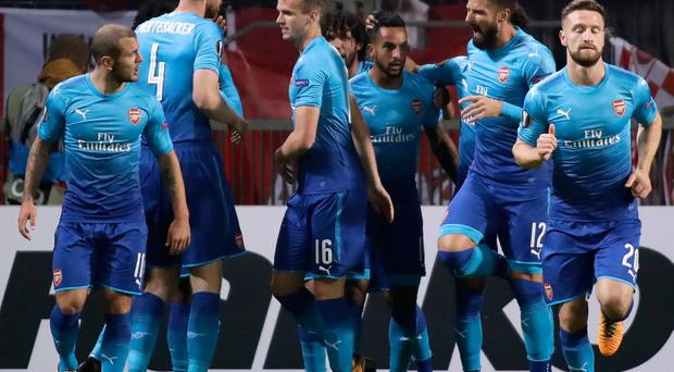 Arsenal's Theo Walcott, center right, celebrates after scoring the opening goal during the Europa League group H soccer match between Bate and Arsenal at the Borisov-Arena stadium in Borisov, Belarus, Thursday, Sept. 28, 2017. (AP Photo/Sergei Grits)