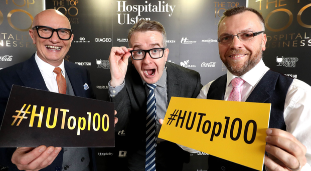 Colin Neill, chief executive of Hospitality Ulster, with mentalist David Meade and chairman Mark Stewart