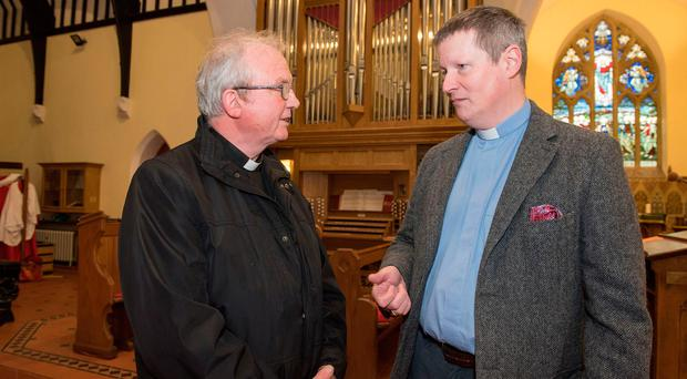 Show of goodwill: right, Robert Miller from Christ Church, in Londonderry with Bishop Donal McKeown following the damage to the church