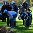 Tricky: Rory McIlroy retrieves his ball from a hazard on the 14th during yesterday's British Masters second round at Close House