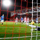 Confident: Graham Dorrans chips home Rangers' fourth goal from the penalty spot