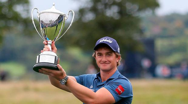 Ireland's Paul Dunne celebrates with the trophy during day four of the British Masters at Close House Golf Club, Newcastle. Pic: Richard Sellers/PA Wire