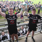 Team effort: Kilcoo joint captains Darragh O'Hanlon and Darryl Branagan lift the trophy yesterday after clinching a sixth successive Down Football title