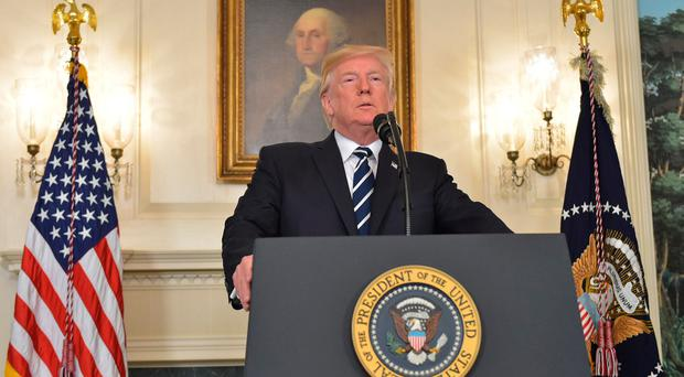 US President Donald Trump delivers a statement on the Las Vegas shooting from the Diplomatic Reception Room of the White House on October 2, 2017. / AFP PHOTO / MANDEL NGANMANDEL NGAN/AFP/Getty Images