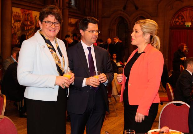 DUP leader Arlene Foster and Sinn Fein's Northern Ireland leader Michelle O'Neill with Northern Ireland Secretary James Brokenshire attend the Ulster fry breakfast at Manchester Town Hall during the Conservative Party Conference at the Manchester Central Convention Complex in Manchester. PRESS ASSOCIATION Photo. Picture date: Tuesday October 3, 2017. See PA TORY stories. Photo credit should read: Owen Humphreys/PA Wire